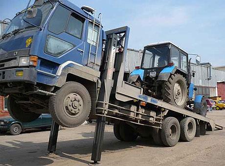 Перевозка трактора манипулятором в Москве и МО